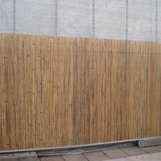 Foto van Bamboemat op bouwhek kunstofvoet en klemmen